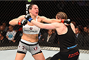 MONTREAL, QC - APRIL 25:   (R-L) Sarah Kaufman of Canada and Alexis Davis of Canada trade punches in their women's bantamweight bout during the UFC 186 event at the Bell Centre on April 25, 2015 in Montreal, Quebec, Canada. (Photo by Josh Hedges/Zuffa LLC/Zuffa LLC via Getty Images)