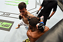 MONTREAL, QC - APRIL 25:   (L-R) Thomas Almeida of Brazil punches Yves Jabouin of Canada in their bantamweight bout during the UFC 186 event at the Bell Centre on April 25, 2015 in Montreal, Quebec, Canada. (Photo by Josh Hedges/Zuffa LLC/Zuffa LLC via Getty Images)