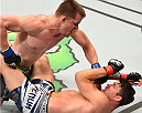 MONTREAL, QC - APRIL 25:   (L-R) CB Dollaway of the United States punches Michael Bisping of England in their middleweight bout during the UFC 186 event at the Bell Centre on April 25, 2015 in Montreal, Quebec, Canada. (Photo by Josh Hedges/Zuffa LLC/Zuffa LLC via Getty Images)
