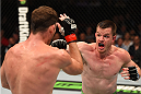 MONTREAL, QC - APRIL 25:   (R-L) CB Dollaway of the United States punches Michael Bisping of England in their middleweight bout during the UFC 186 event at the Bell Centre on April 25, 2015 in Montreal, Quebec, Canada. (Photo by Josh Hedges/Zuffa LLC/Zuffa LLC via Getty Images)