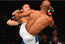 MONTREAL, QC - APRIL 25:   (R-L) Demetrious Johnson of the United States kicks Kyoji Horiguchi of Japan in their UFC flyweight championship bout during the UFC 186 event at the Bell Centre on April 25, 2015 in Montreal, Quebec, Canada. (Photo by Josh Hedges/Zuffa LLC/Zuffa LLC via Getty Images)
