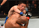 MONTREAL, QC - APRIL 25:   (L-R) Kyoji Horiguchi of Japan punches Demetrious Johnson of the United States in their UFC flyweight championship bout during the UFC 186 event at the Bell Centre on April 25, 2015 in Montreal, Quebec, Canada. (Photo by Josh Hedges/Zuffa LLC/Zuffa LLC via Getty Images)