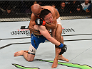 MONTREAL, QC - APRIL 25:   (R-L) Demetrious Johnson of the United States attempts a rear choke submission against Kyoji Horiguchi of Japan in their UFC flyweight championship bout during the UFC 186 event at the Bell Centre on April 25, 2015 in Montreal, Quebec, Canada. (Photo by Josh Hedges/Zuffa LLC/Zuffa LLC via Getty Images)