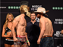 ADELAIDE, AUSTRALIA - MAY 09:   (L-R) Opponents Vik Grujic of Australia and Brendan O'Reilly of Australia face off during the UFC weigh-in event at the Adelaide Entertainment Centre on May 9, 2015 in Adelaide, Australia. (Photo by Josh Hedges /Zuffa LLC/Zuffa LLC via Getty Images)