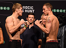 ADELAIDE, AUSTRALIA - MAY 09:   (L-R) Opponents Jake Matthews of Australia and James Vick of the United States face off during the UFC weigh-in event at the Adelaide Entertainment Centre on May 9, 2015 in Adelaide, Australia. (Photo by Josh Hedges/Zuffa LLC/Zuffa LLC via Getty Images)