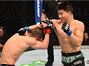 ADELAIDE, AUSTRALIA - MAY 10:   (R-L) Ben Nguyen punches Alptekin Ozkilic in their flyweight bout during the UFC Fight Night event at the Adelaide Entertainment Centre on May 10, 2015 in Adelaide, Australia. (Photo by Josh Hedges/Zuffa LLC/Zuffa LLC via Getty Images)