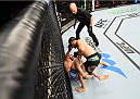 ADELAIDE, AUSTRALIA - MAY 10:    Ben Nguyen (top) punches Alptekin Ozkilic in their flyweight bout during the UFC Fight Night event at the Adelaide Entertainment Centre on May 10, 2015 in Adelaide, Australia. (Photo by Josh Hedges/Zuffa LLC/Zuffa LLC via Getty Images)