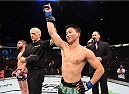 ADELAIDE, AUSTRALIA - MAY 10:   (R-L) Ben Nguyen celebrates his victory over Alptekin Ozkilic in their flyweight bout during the UFC Fight Night event at the Adelaide Entertainment Centre on May 10, 2015 in Adelaide, Australia. (Photo by Josh Hedges/Zuffa LLC/Zuffa LLC via Getty Images)