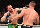 ADELAIDE, AUSTRALIA - MAY 10:   (L-R) Brendan O'Reilly punches Vik Grujicin their welterweight bout during the UFC Fight Night event at the Adelaide Entertainment Centre on May 10, 2015 in Adelaide, Australia. (Photo by Josh Hedges/Zuffa LLC/Zuffa LLC via Getty Images)