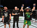 ADELAIDE, AUSTRALIA - MAY 10:   (R-L) Brendan O'Reilly celebrates his victory over Vik Grujicin their welterweight bout during the UFC Fight Night event at the Adelaide Entertainment Centre on May 10, 2015 in Adelaide, Australia. (Photo by Josh Hedges/Zuffa LLC/Zuffa LLC via Getty Images)