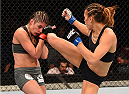 ADELAIDE, AUSTRALIA - MAY 10:   (R-L) Kailin Curran kicks Alex Chambers in their women's strawweight bout during the UFC Fight Night event at the Adelaide Entertainment Centre on May 10, 2015 in Adelaide, Australia. (Photo by Josh Hedges/Zuffa LLC/Zuffa LLC via Getty Images)