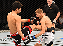 ADELAIDE, AUSTRALIA - MAY 10:   (L-R) Hatsu Hioki kicks Daniel Hooker in their featherweight bout during the UFC Fight Night event at the Adelaide Entertainment Centre on May 10, 2015 in Adelaide, Australia. (Photo by Josh Hedges/Zuffa LLC/Zuffa LLC via Getty Images)