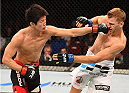 ADELAIDE, AUSTRALIA - MAY 10:   (L-R) Hatsu Hioki punches Daniel Hooker in their featherweight bout during the UFC Fight Night event at the Adelaide Entertainment Centre on May 10, 2015 in Adelaide, Australia. (Photo by Josh Hedges/Zuffa LLC/Zuffa LLC via Getty Images)