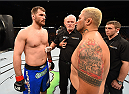 ADELAIDE, AUSTRALIA - MAY 10:   (L-R) Stipe Miocic and Mark Hunt face off before their heavyweight bout during the UFC Fight Night event at the Adelaide Entertainment Centre on May 10, 2015 in Adelaide, Australia. (Photo by Josh Hedges/Zuffa LLC/Zuffa LLC via Getty Images)