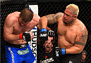ADELAIDE, AUSTRALIA - MAY 10:   (R-L) Mark Hunt punches Stipe Miocic in their heavyweight bout during the UFC Fight Night event at the Adelaide Entertainment Centre on May 10, 2015 in Adelaide, Australia. (Photo by Josh Hedges/Zuffa LLC/Zuffa LLC via Getty Images)