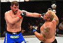 ADELAIDE, AUSTRALIA - MAY 10:   (L-R) Stipe Miocic punches Mark Hunt in their heavyweight bout during the UFC Fight Night event at the Adelaide Entertainment Centre on May 10, 2015 in Adelaide, Australia. (Photo by Josh Hedges/Zuffa LLC/Zuffa LLC via Getty Images)