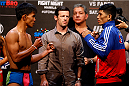 PASAY, METRO MANILA, PHILIPPINES - MAY 15: (L and R) Roldan Sangcha-an and Jon Delos Reyes face-off during the UFC weigh-in event at the Mall of Asia Arena on May 15, 2015 in Pasay, Metro Manila, Philippines. (Photo by Mitch Viquez/Zuffa LLC/Zuffa LLC via Getty Images)