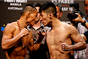 PASAY, METRO MANILA, PHILIPPINES - MAY 15: (L and R) Ning Guangyou and Royston Wee face-off during the UFC weigh-in event at the Mall of Asia Arena on May 15, 2015 in Pasay, Metro Manila, Philippines. (Photo by Mitch Viquez/Zuffa LLC/Zuffa LLC via Getty Images)