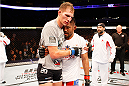 MANILA, PHILIPPINES - MAY 16: (L to R) Luke Barnatt of England and Mark Munoz of the United States embrace after their middleweight fight during the UFC Fight Night event at the Mall of Asia Arena on May 16, 2015 in Manila, Philippines. (Photo by Mitch Viquez/Zuffa LLC/Zuffa LLC via Getty Images)