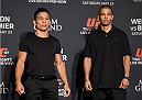 LAS VEGAS, NEVADA - MAY 21: (L-R) Joseph Benavides and John Moraga face-off during the UFC 187 Ultimate Media Day at the MGM Grand Hotel/Casino on May 21, 2015 in Las Vegas Nevada. (Photo by Brandon Magnus/Zuffa LLC/Zuffa LLC via Getty Images)
