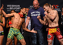 LAS VEGAS, NV - MAY 22:   (L-R) Opponents John Dodson and Zach Makovsky face off during the UFC 187 weigh-in at the MGM Grand Conference Center on May 22, 2015 in Las Vegas, Nevada. (Photo by Josh Hedges/Zuffa LLC/Zuffa LLC via Getty Images)