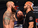 LAS VEGAS, NV - MAY 22:   (L-R) Opponents Travis Browne and Andrei Arlovski of Belarus face off during the UFC 187 weigh-in at the MGM Grand Conference Center on May 2, 2015 in Las Vegas, Nevada. (Photo by Josh Hedges/Zuffa LLC/Zuffa LLC via Getty Images)