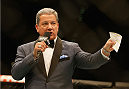 LAS VEGAS, NV - MAY 23:  Bruce Buffer introduces Mike Pyle and Colby Covington before their welterweight bout during the UFC 187 event at the MGM Grand Garden Arena on May 23, 2015 in Las Vegas, Nevada.  (Photo by Christian Petersen/Zuffa LLC/Zuffa LLC via Getty Images)