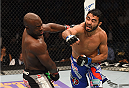 LAS VEGAS, NV - MAY 23:  (R-L) Rafael Natal of Brazil punches Uriah Hall in their middleweight bout during the UFC 187 event at the MGM Grand Garden Arena on May 23, 2015 in Las Vegas, Nevada.  (Photo by Josh Hedges/Zuffa LLC/Zuffa LLC via Getty Images)