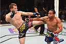 LAS VEGAS, NV - MAY 23:  (L-R) Zach Makovsky kicks John Dodson in their flyweight bout during the UFC 187 event at the MGM Grand Garden Arena on May 23, 2015 in Las Vegas, Nevada.  (Photo by Josh Hedges/Zuffa LLC/Zuffa LLC via Getty Images)
