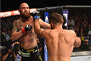 LAS VEGAS, NV - MAY 23:  (L-R) Travis Browne punches Andrei Arlovski in their heavyweight bout during the UFC 187 event at the MGM Grand Garden Arena on May 23, 2015 in Las Vegas, Nevada.  (Photo by Josh Hedges/Zuffa LLC/Zuffa LLC via Getty Images)