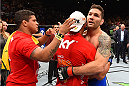 LAS VEGAS, NV - MAY 23:  (R-L) Chris Weidman and Vitor Belfort of Brazil embrace after their UFC middleweight championship bout during the UFC 187 event at the MGM Grand Garden Arena on May 23, 2015 in Las Vegas, Nevada.  (Photo by Josh Hedges/Zuffa LLC/Zuffa LLC via Getty Images)