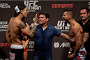 GOIANIA, BRAZIL - MAY 29:  Featherweight fighters Lucas Martins (L) of Brazil and Mirsad Bektic of Bosnia face off during the UFC Fight Night Weigh-ins at Goiania Arena on May 29, 2015 in Goiania, Brazil.  (Photo by Buda Mendes/Zuffa LLC/Zuffa LLC via Getty Images)