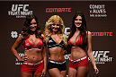 GOIANIA, BRAZIL - MAY 29: Octagon girls Luciana Andrade, Jhenny Andrade, Camila  Oliveira pose for photographers after the UFC Fight Night Weigh-ins at Goiania Arena on May 29, 2015 in Goiania, Brazil. (Photo by Buda Mendes/Zuffa LLC/Zuffa LLC via Getty Images)