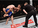 GOIANIA, BRAZIL - MAY 30:  Charles Oliveira attempts to submit Nick Lentz of the United States in their featherweight UFC bout during the UFC Fight Night event at Arena Goiania on May 30, 2015 in Goiania, Brazil.  (Photo by Buda Mendes/Zuffa LLC/Zuffa LLC via Getty Images)
