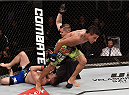GOIANIA, BRAZIL - MAY 30:  Charles Oliveira submits Nick Lentz of the United States in their featherweight UFC bout during the UFC Fight Night event at Arena Goiania on May 30, 2015 in Goiania, Brazil.  (Photo by Buda Mendes/Zuffa LLC/Zuffa LLC via Getty Images)
