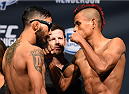 NEW ORLEANS, LA - JUNE 05:   (L-R) Opponents Jose Quinonez of Mexico and Leonardo Morales of Nicaragua face off during the UFC weigh-in at the Smoothie King Center on June 5, 2015 in New Orleans, Louisiana. (Photo by Josh Hedges/Zuffa LLC/Zuffa LLC via Getty Images)