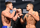 NEW ORLEANS, LA - JUNE 05:   (L-R) Opponents Chris Wade and Christos Giagos face off during the UFC weigh-in at the Smoothie King Center on June 5, 2015 in New Orleans, Louisiana. (Photo by Josh Hedges/Zuffa LLC/Zuffa LLC via Getty Images)