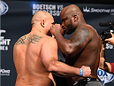 NEW ORLEANS, LA - JUNE 05:   (L-R) Opponents Shawn Jordan and Derrick Lewis face off during the UFC weigh-in at the Smoothie King Center on June 5, 2015 in New Orleans, Louisiana. (Photo by Josh Hedges/Zuffa LLC/Zuffa LLC via Getty Images)