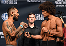 NEW ORLEANS, LA - JUNE 05:   (L-R) Opponents Francisco Rivera and Alex Caceres face off during the UFC weigh-in at the Smoothie King Center on June 5, 2015 in New Orleans, Louisiana. (Photo by Josh Hedges/Zuffa LLC/Zuffa LLC via Getty Images)