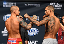 NEW ORLEANS, LA - JUNE 05:  (L-R) Opponents Dustin Poirier and Yancy Medeiros face off during the UFC weigh-in at the Smoothie King Center on June 5, 2015 in New Orleans, Louisiana. (Photo by Josh Hedges/Zuffa LLC/Zuffa LLC via Getty Images)
