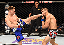 NEW ORLEANS, LA - JUNE 06:   (L-R) Chris Wade kicks Christos Giagos in their lightweight bout during the UFC event at the Smoothie King Center on June 6, 2015 in New Orleans, Louisiana. (Photo by Josh Hedges/Zuffa LLC/Zuffa LLC via Getty Images)