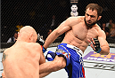 NEW ORLEANS, LA - JUNE 06:   (R-L) Omari Akhmedov kicks Brian Ebersole in their welterweight bout during the UFC event at the Smoothie King Center on June 6, 2015 in New Orleans, Louisiana. (Photo by Josh Hedges/Zuffa LLC/Zuffa LLC via Getty Images)