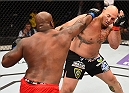 NEW ORLEANS, LA - JUNE 06:   (L-R) Derrick Lewis punches Shawn Jordan in their heavyweight bout during the UFC event at the Smoothie King Center on June 6, 2015 in New Orleans, Louisiana. (Photo by Josh Hedges/Zuffa LLC/Zuffa LLC via Getty Images)