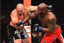 NEW ORLEANS, LA - JUNE 06:   (R-L) Derrick Lewis punches Shawn Jordan in their heavyweight bout during the UFC event at the Smoothie King Center on June 6, 2015 in New Orleans, Louisiana. (Photo by Josh Hedges/Zuffa LLC/Zuffa LLC via Getty Images)