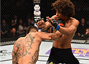 NEW ORLEANS, LA - JUNE 06:   (L-R) Francisco Rivera punches Alex Caceres in their bantamweight bout during the UFC event at the Smoothie King Center on June 6, 2015 in New Orleans, Louisiana. (Photo by Josh Hedges/Zuffa LLC/Zuffa LLC via Getty Images)