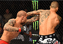 NEW ORLEANS, LA - JUNE 06:  (L-R) Dustin Poirier punches Yancy Medeiros in their lightweight bout during the UFC event at the Smoothie King Center on June 6, 2015 in New Orleans, Louisiana. (Photo by Josh Hedges/Zuffa LLC/Zuffa LLC via Getty Images)
