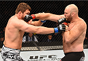 NEW ORLEANS, LA - JUNE 06:   (R-L) Ben Rothwell punches Matt Mitrione in their heavyweight bout during the UFC event at the Smoothie King Center on June 6, 2015 in New Orleans, Louisiana. (Photo by Josh Hedges/Zuffa LLC/Zuffa LLC via Getty Images)
