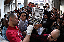 MEXICO CITY, MEXICO - JUNE 10:  UFC heavyweight champion Cain Velasquez interacts with fans during the UFC 188 open workouts at the Interactive Museum of Economics on June 10, 2015 in Mexico City, Mexico. (Photo by Jeff Bottari/Zuffa LLC/Zuffa LLC via Getty Images)