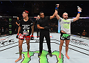 MEXICO CITY, MEXICO - JUNE 13:  (R-L) Cathal Pendred of Ireland celebrates his victory over Augusto Montana of Mexico in their welterweight bout during the UFC 188 event at the Arena Ciudad de Mexico on June 13, 2015 in Mexico City, Mexico. (Photo by Josh Hedges/Zuffa LLC/Zuffa LLC via Getty Images)
