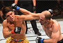 MEXICO CITY, MEXICO - JUNE 13:  (L-R) Henry Cejudo of the United States exchanges punches with Chico Camus of the United States in their flyweight bout during the UFC 188 event at the Arena Ciudad de Mexico on June 13, 2015 in Mexico City, Mexico. (Photo by Josh Hedges/Zuffa LLC/Zuffa LLC via Getty Images)